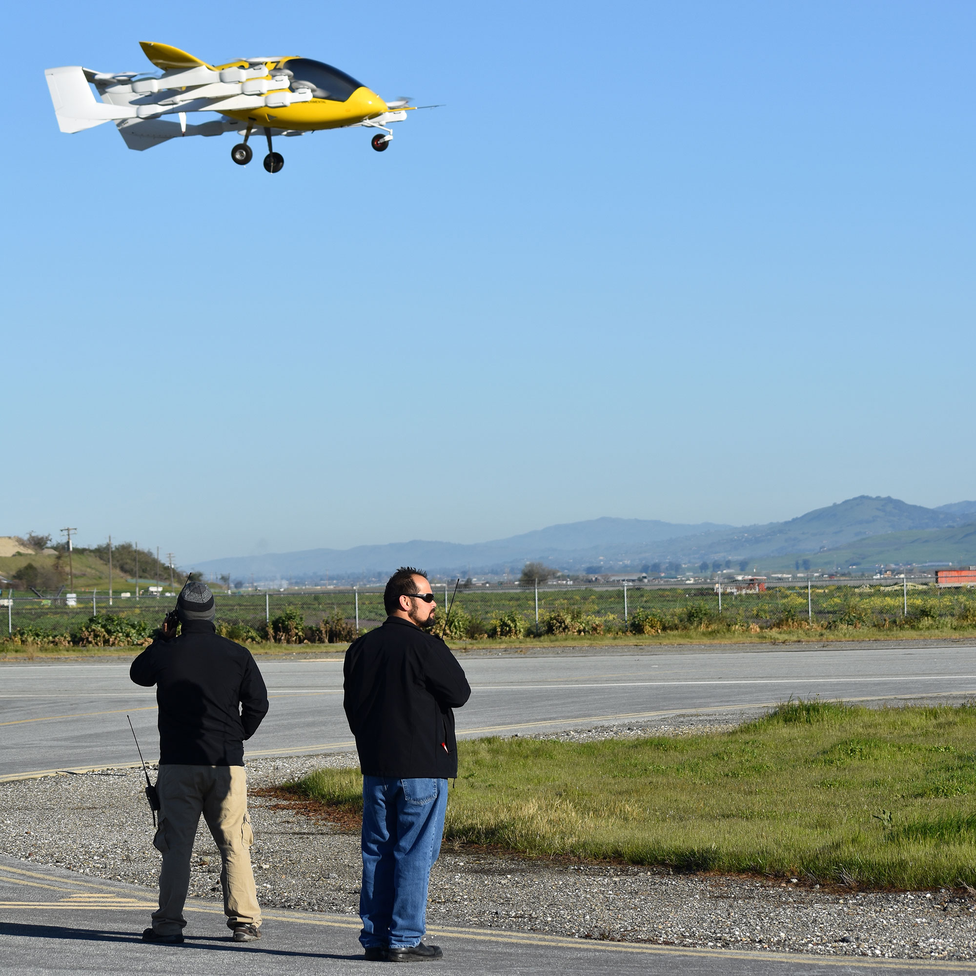 Ground crew monitors Cora during hover flight test
