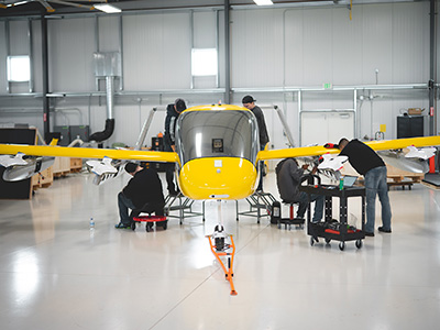 Workers assembling the aircraft