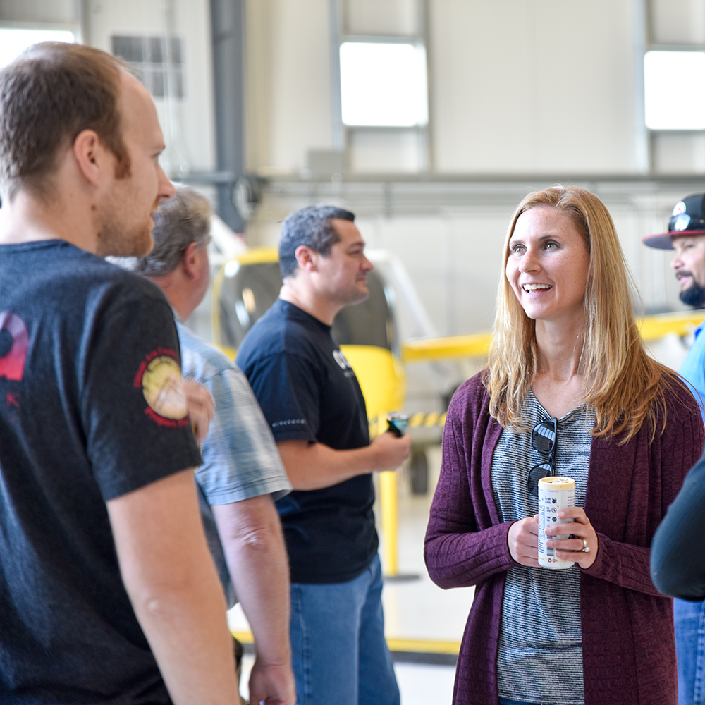 Group of Wisk employees in discussion